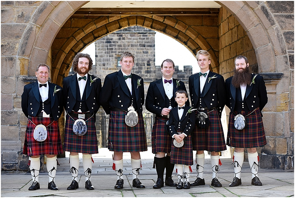 Hoghton Tower wedding photography, pictured are the groom and his groomsmen wearing kilts.