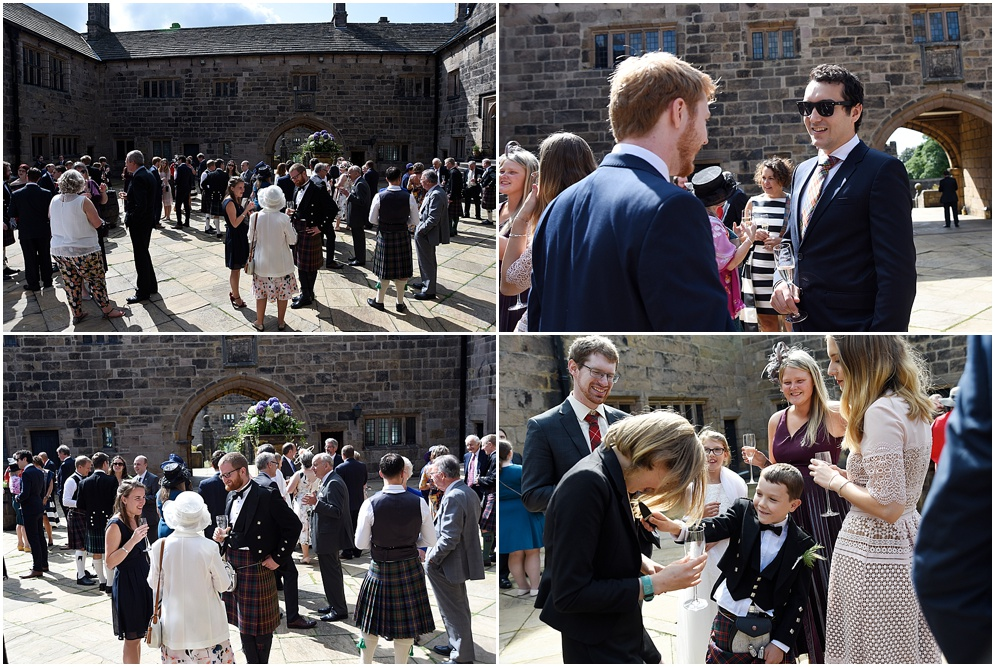 Guests enjoy the sunshine in the courtyard before the wedding ceremony. Hoghton Tower wedding photography