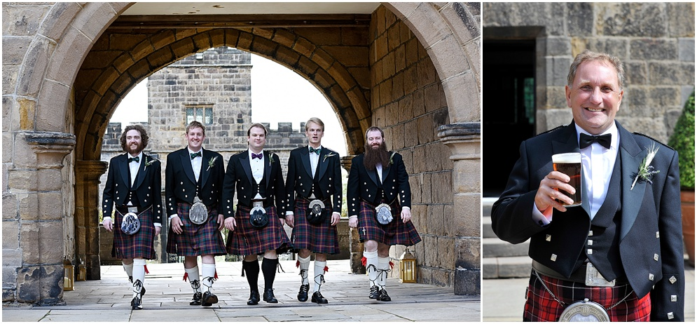 Groomsmen wearing kilts walk through the archway of Hoghton Tower on his wedding day. Wedding photography in Lancashire.