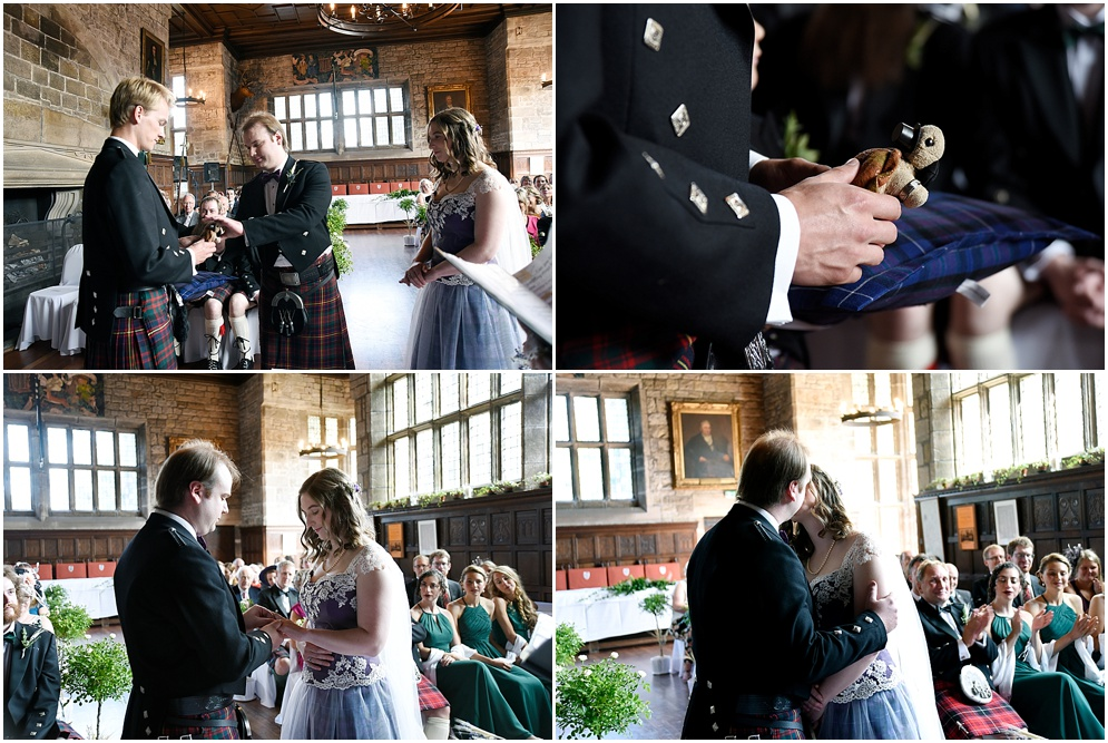 Bride and groom share their first kiss during their wedding ceremony at Hoghton Tower.