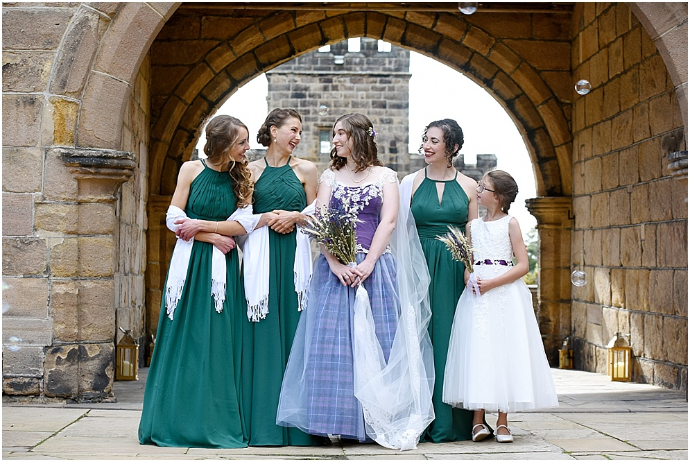 Wedding at Hoghton tower. Bride pictured with her bridesmaids under the archway.