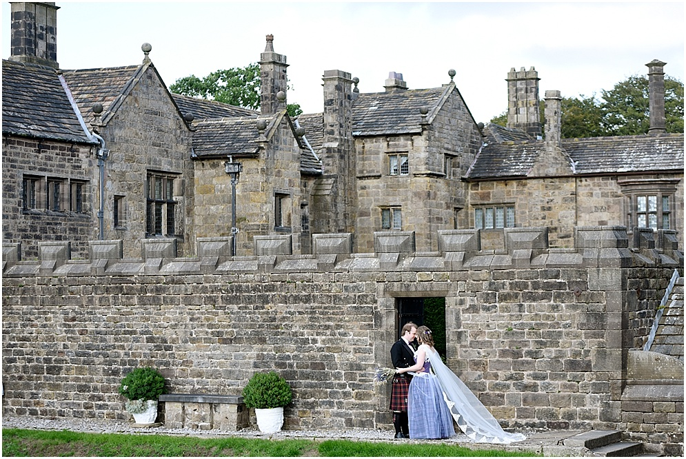 Bride and groom pictured with Hoghton Tower behind them. Hoghton Tower wedding photography.