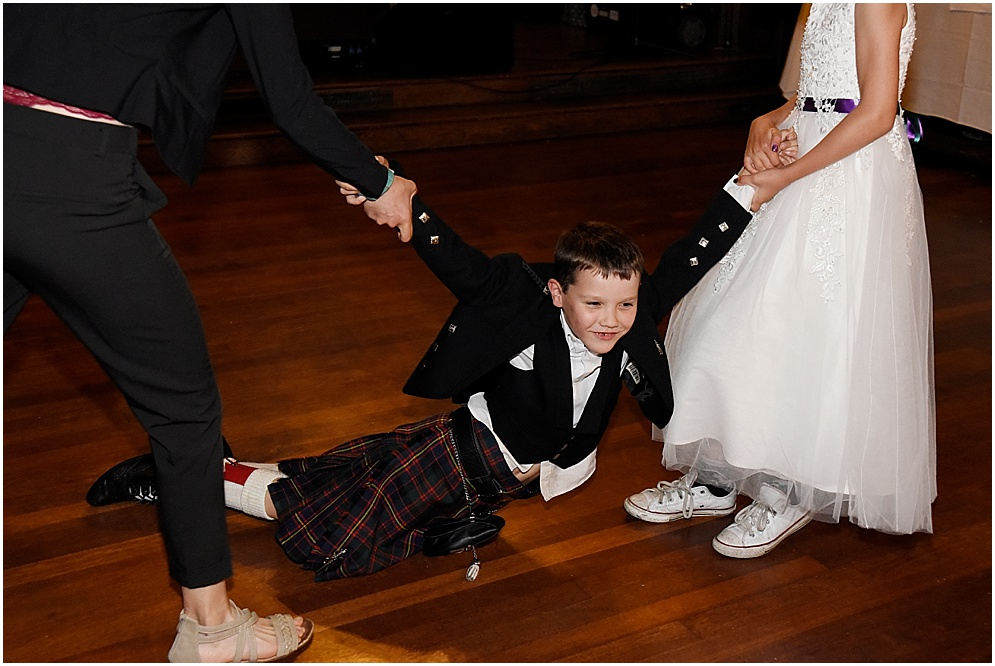 Guest on the dance floor at a wedding at Hoghton Tower. Lancashire wedding photography.