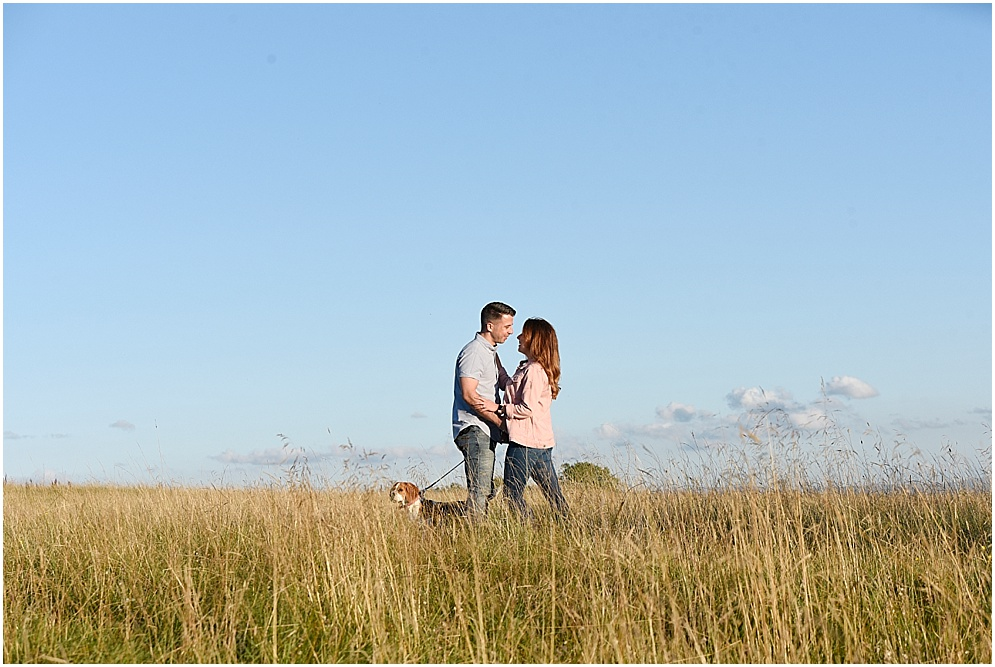 Wedding photography in Rochdale, engagement picture of a couple stood in the long grass.