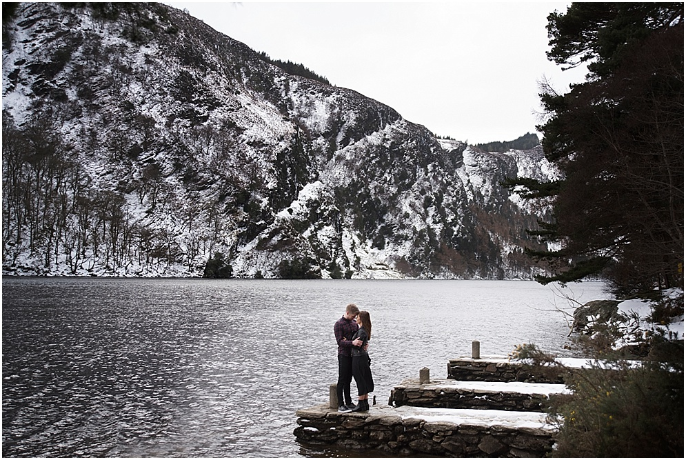 Couple pictured on the shores of Glendalough in Ireland. Wicklow wedding photography.